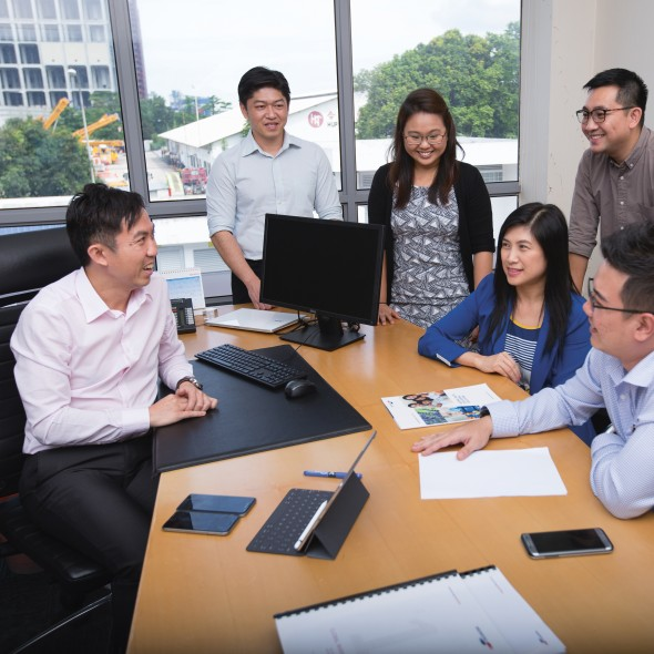 Weiseong Fong in a meeting