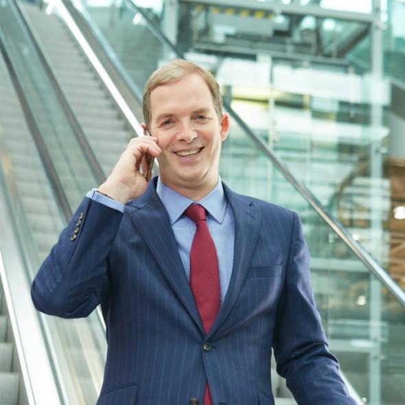 Jon Birrel phoning on a stairmaster