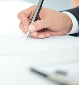 Man Signing Contract Paper