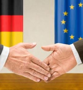 Representatives of Germany and the EU shake hands