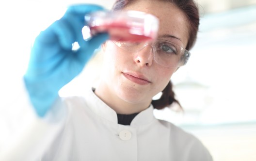 Young female scientist at work in lab
